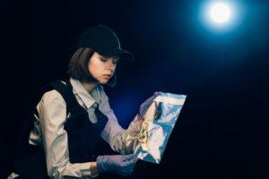 Investigator holding bag